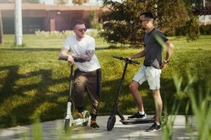 men riding e scooter - staying safe on an electric scooter and scooter injuries - viles and beckman - fort myers florida