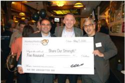 Jim Vinz, Co-CEO of Le Duff America, accepts a $5000 donation on behalf of Share Our Strength