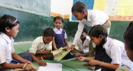Children issuing books at the Anandghar library in Kajrah village in Balaghat. (Photo by Cosmos Joseph)