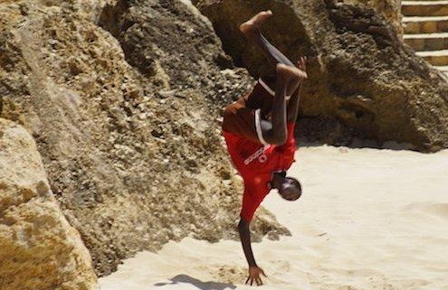 Maio beach with upside down boy