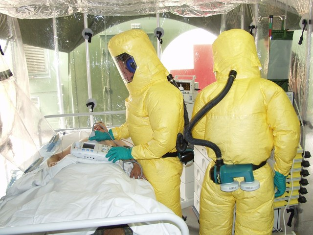 Health professionals examining someone with Ebola disease.