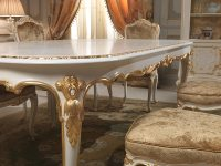 Dining table in Louis XV style, particular of the carvings ...