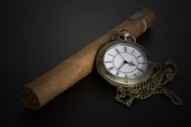 pocket watch and cigar