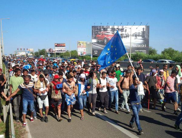 EU flag bearer, the migrant march from Budapest to the Austrian and German borders. September 4th 2015
