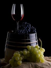 Still Life with a glass of wine and grapes barrel