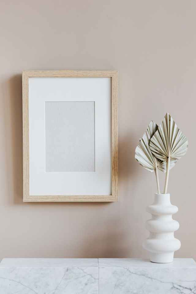 scandinavian room interior with mockup photo frame and vase
