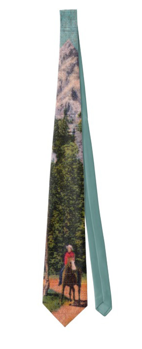 Neck tie with an old fashioned image of cowboy on a horse in front of big mountains.