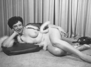 Short haired brunette lounging nude