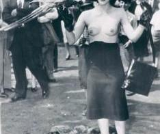 Topless woman with Parrott