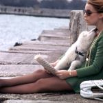 Claudia Jennings reading by the shoreline in Chicago