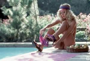 Kym Malin - dressing by the pool