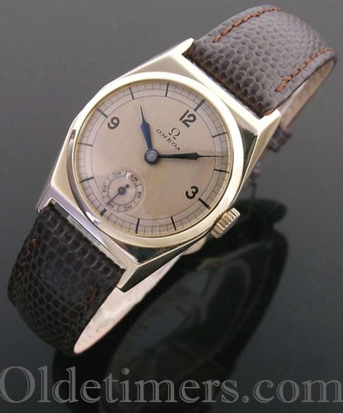 1930s 9ct gold tonneau vintage Omega watch