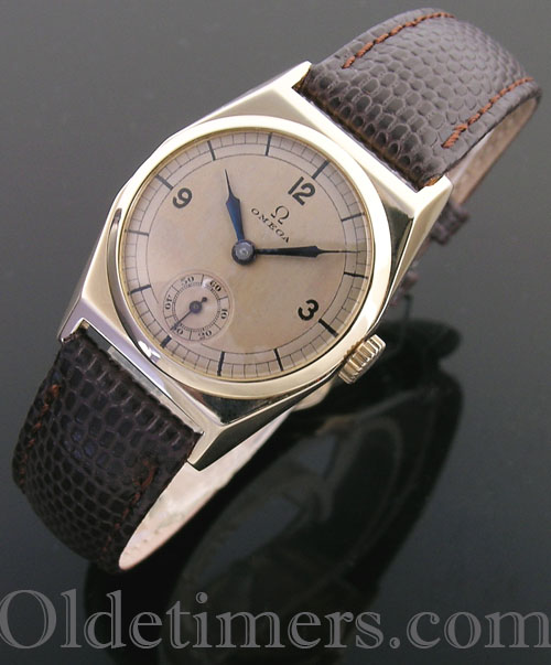 1930s 9ct gold tonneau vintage Omega watch