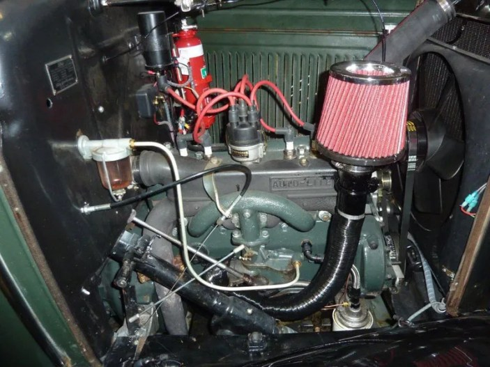 The Ford was originally designed for left hand drive and when converted to right hand drive the steering column made it nearly impossible to fit an air cleaner to the carburettor inlet and nearly all Model A cars that were RHD ran without an intake filter!!! It is vitally important to fit an intake air filter.Notice the dual accelerator linkage. The existing linkages remain but I have fitted a conventional cable operated right hand accelerator. The original accelerator pedal was between the clutch and the brake pedal and this position really leads to ankle soreness after a few days of rallying.