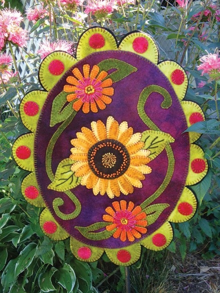 Summer sunflower  zinnias Wool applique design pattern shown as wall hanging or penny rug