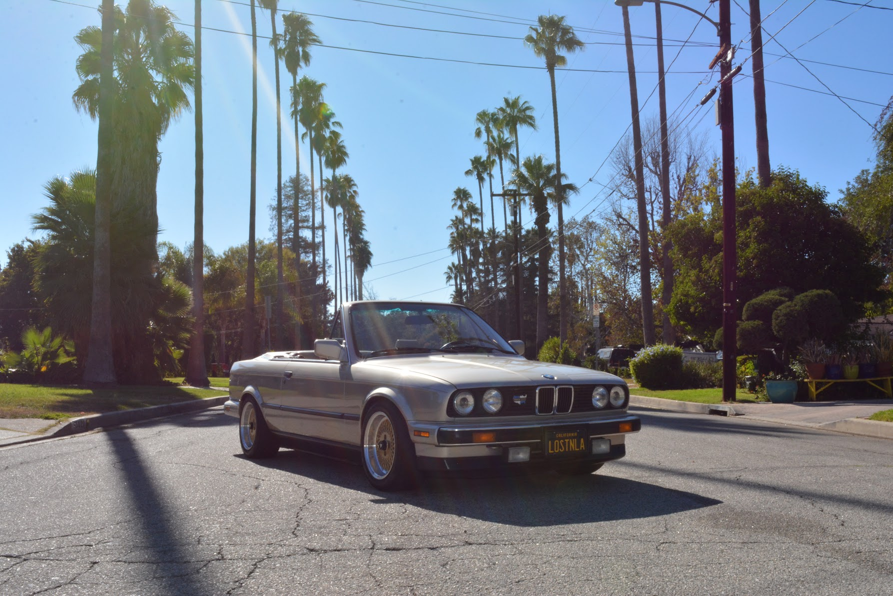 1988 BMW 325i Cabriolet in rare Benzitbeige-metallic with heated sport  seats matted to a 5 speed manual transmission with 3.73 limited slip  differential.