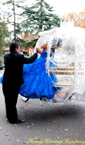 Father assisting  la Quinceanera board her carriage