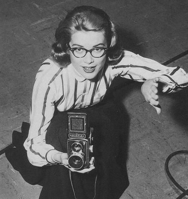 Grace Kelly 1950s holding a camera