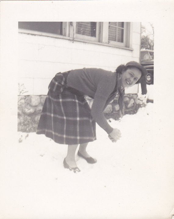 1940s woman in vintage plaid skirt in winter