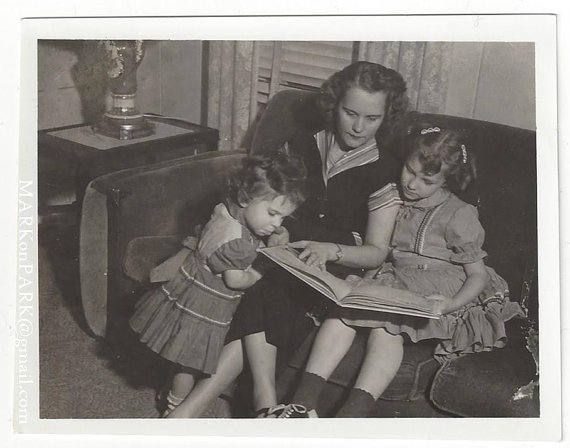 1950s mother reading to daughters vintage image