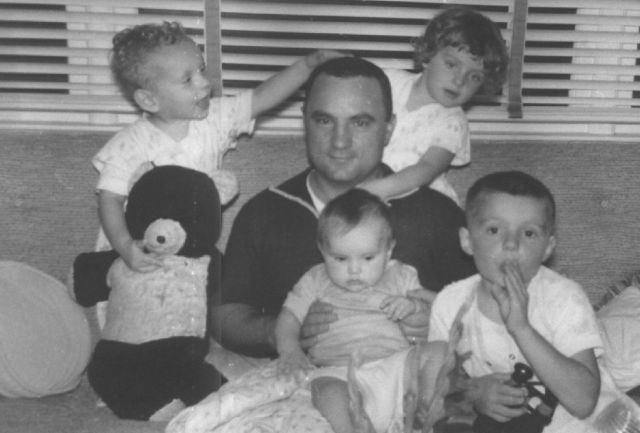 1950s vintage image of father with children