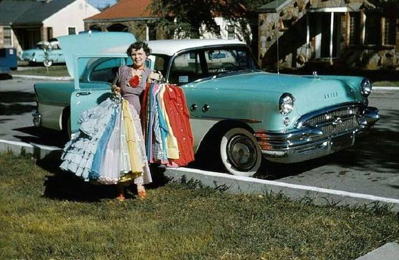 1950s woman in front of 50s car with 1950s dresses