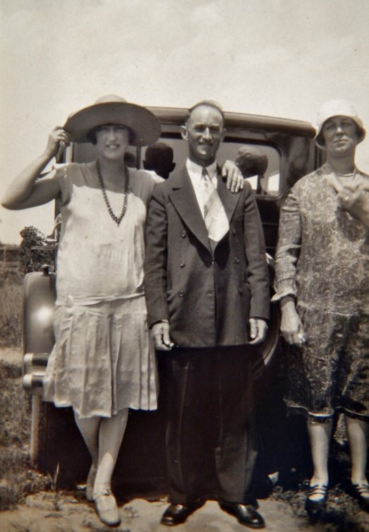 1920s-family-in-front-of-car-dressed-as-flappers-vintage-image
