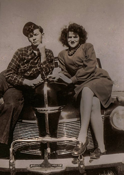 1940s-couple-sitting-on-a-car-vintage-image
