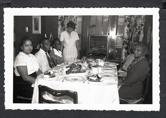 1950's african american family at thanksgiving dinner vintage image