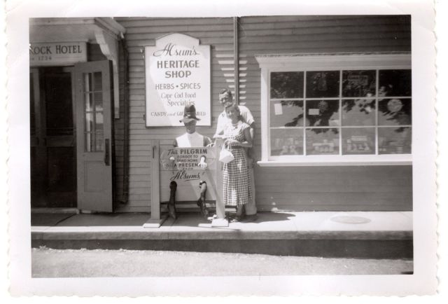 1950s vacation photos of a couple at a shop vintage