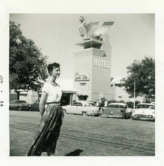 1950s vintage image of woman in front of a hotel