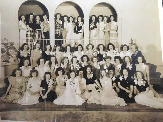 1940's vintage image of girls all dressed up for a dance