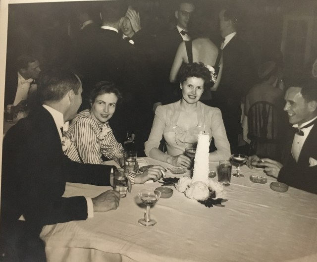1940's vintage photo of couples at a fancy dinner