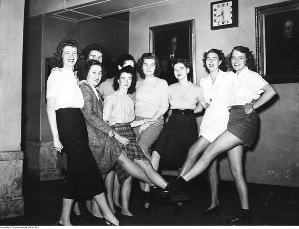 1940s image of university students dancing in a kick line, women