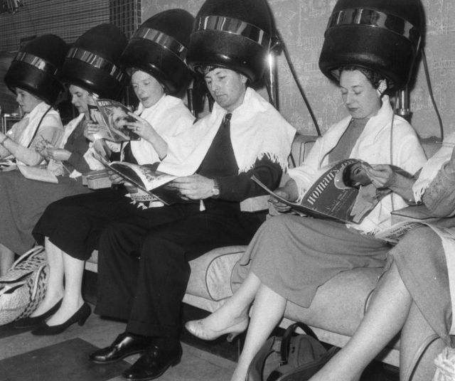 vintage hair salon with woman and men - getty images