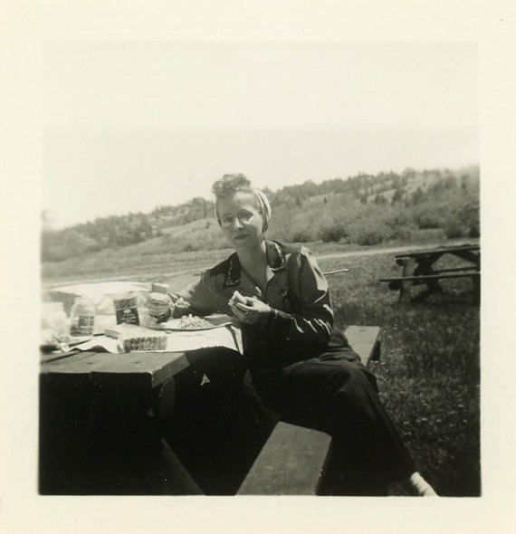 1940s vintage woman eating food at a picnic