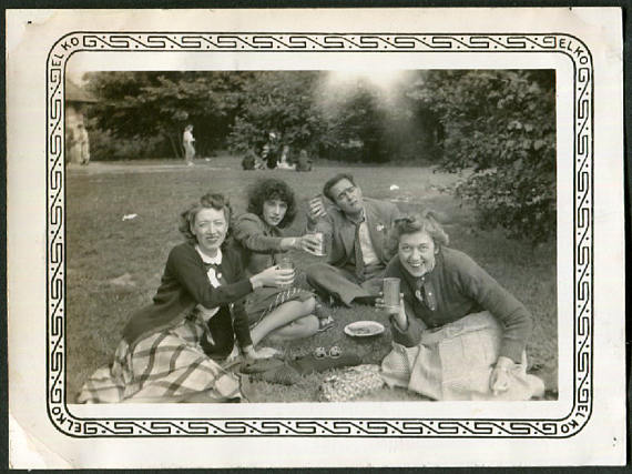 Vintage Photo of Friends Lifting Their Glasses on a Picnic, 1940's