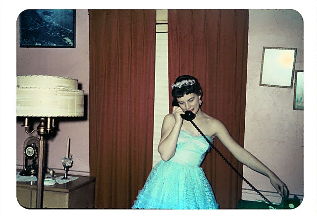 Before the dance, 1958 girl in a fancy gown in her livingroom vintage image