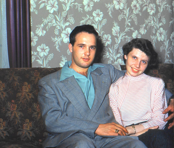 1950s photo of a young couple on a couch