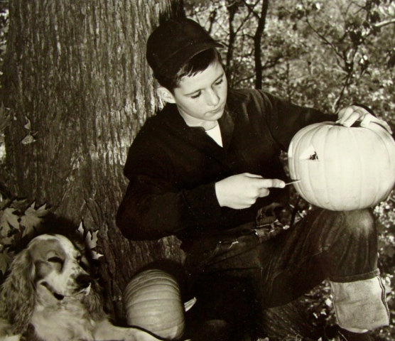 1950s Photo of a boy carving a pumpkin vintage