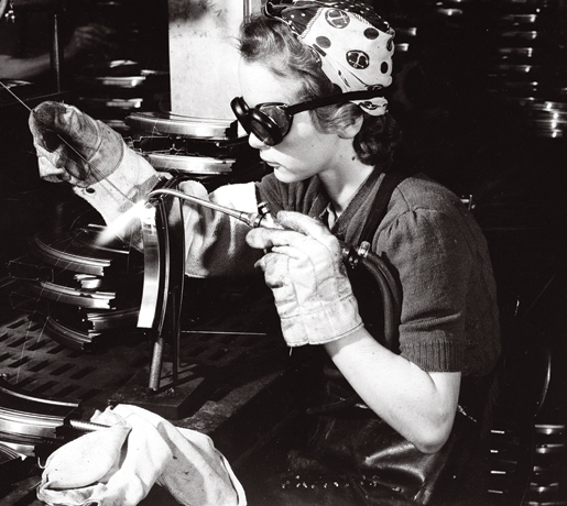 A welder works on a Bren gun at John Inglis Company Ltd 1942 vintage photo