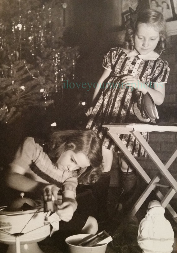 1940s vintage image of two little girls with tree and gifts
