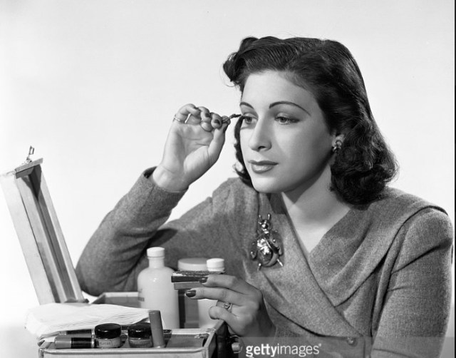 Bea Wain, singer on CBS Radios popular music program, Your Hit Parade. Here, She applies makeup. Image dated October 1, 1940. New York, NY.