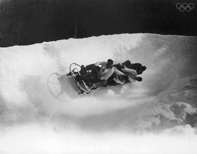 The British four-man bobsleigh team in action at the Winter Olympics at Chamonix, February 1924.