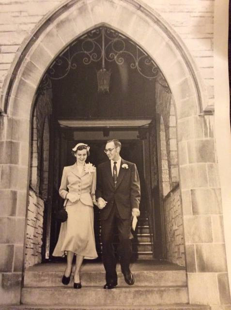 vintage 1950s wedding photo of a young couple coming out of the church