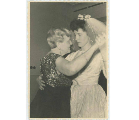 vintage photo of 1950s bride dancing with her mother