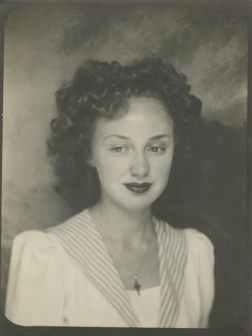 1940s Vintage Photo Of A Young Woman In A Photo Booth With
