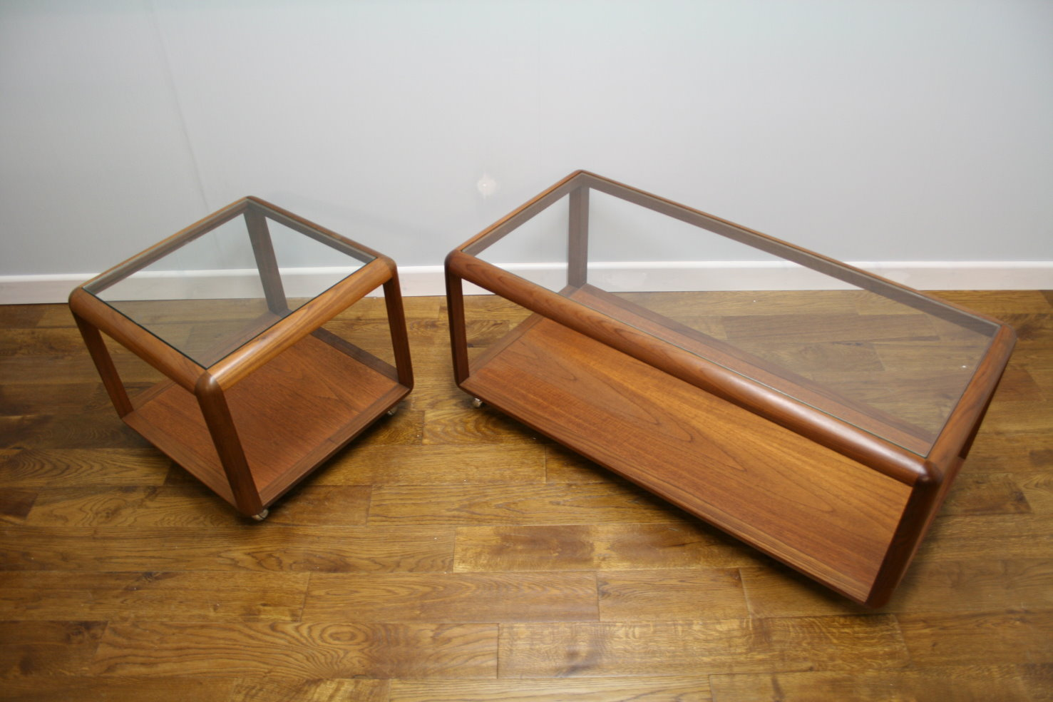 70s G Plan teak and glass coffee tables