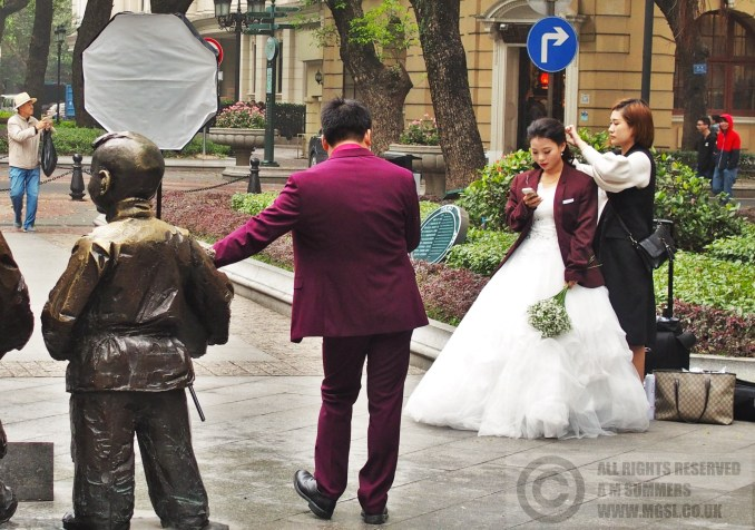 Wedding shoot. The bride and groom seemed more interested in their smartphones than each other