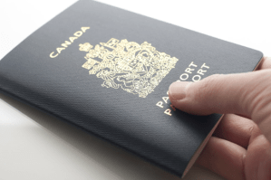 A canadian passport held in an Immigrant investors hand